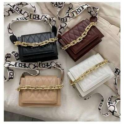 ABSTRACT STRAP AND METAL FASHION STRAP SLING BAG