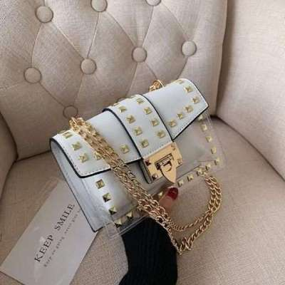 STUDDED TRANSPARENT SLING WITH COLOR POUCH
